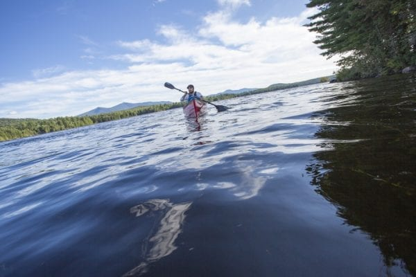 Chris Morris paddles Union Falls Pond on the Saranac River for a story in the November issue. Photo by Mike Lynch
