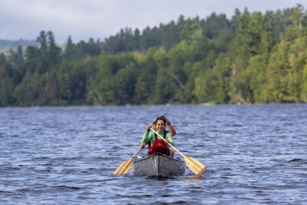 Zoe Agasi, front, and Oliver Van Herck paddle on Franklin Falls Pond. The pair were paddling from Old Forge to Fort Kent, Maine, in August 2019 on the Northern Forest Canoe Trail. Photo by Mike Lynch