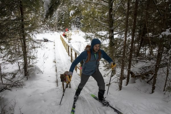 A skier exits the new bridge. Photo by Mike Lynch