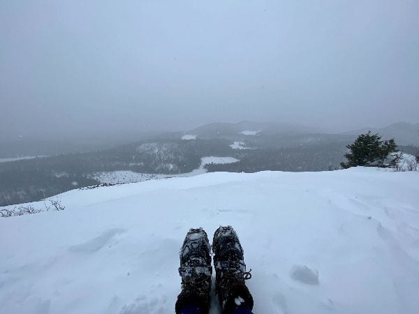 Boots with crampons on snow