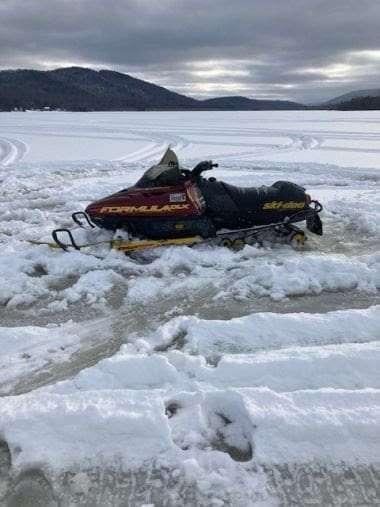 Snowmobile Stuck in Lewey Lake