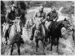 A picture of ranger Bill Petty guiding the Rockefeller brothers on horseback in the Adirondack High Peaks.