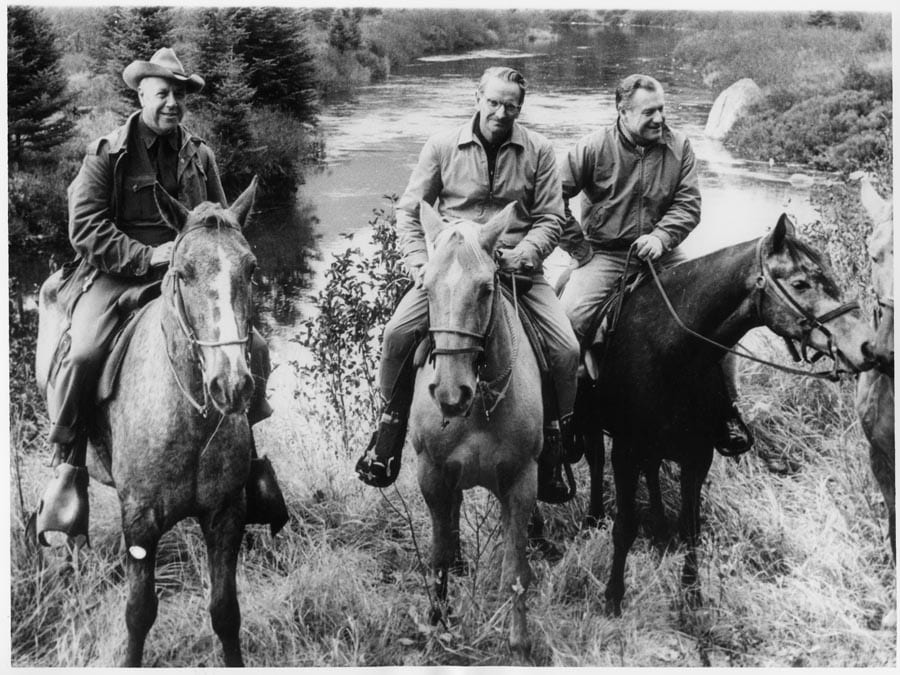 A photo of ranger Bill Petty, Laurance Rockefeller and Gov. Nelson Rockefeller riding horses in the Adirondack High Peaks in 1965.