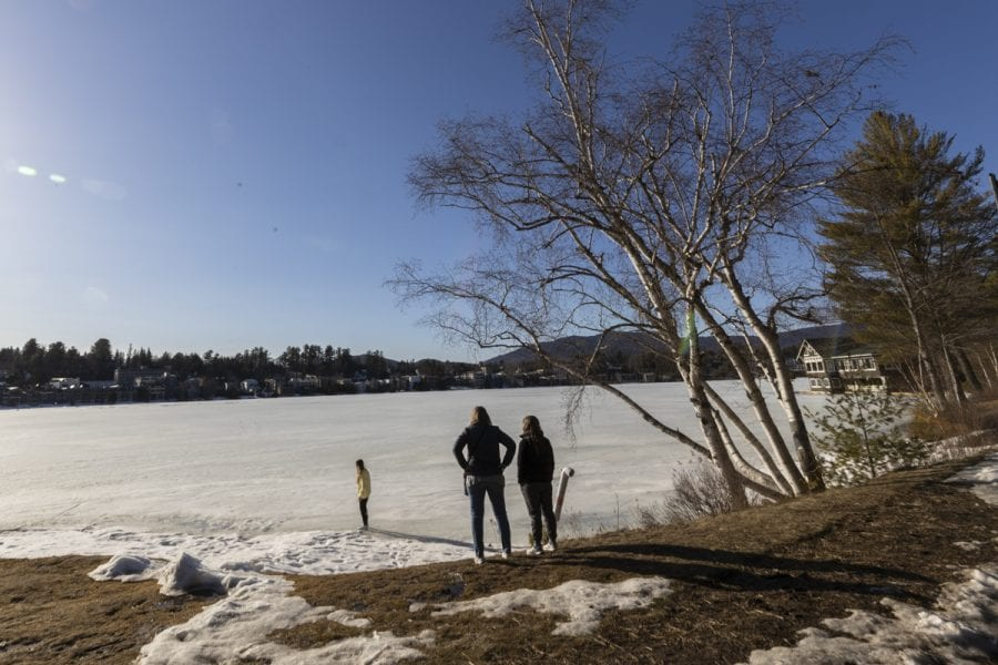The ice-out watch on area lakes has begun with recent warm weather. Mirror Lake in Lake Placid was completely covered with ice on March 22, but should see some melting in the near future. Photo by Mike Lynch