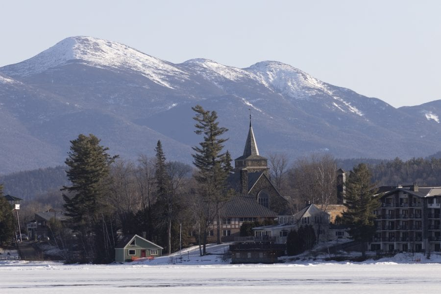 The ice out watch on area lakes has begun with recent warm weather. Mirror Lake in Lake Placid was completely covered with ice on March 22, but should see some melting in the near future. Photo by Mike Lynch