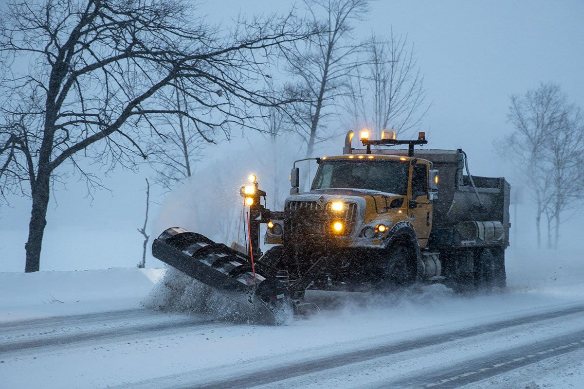 snow plow spreading road salt