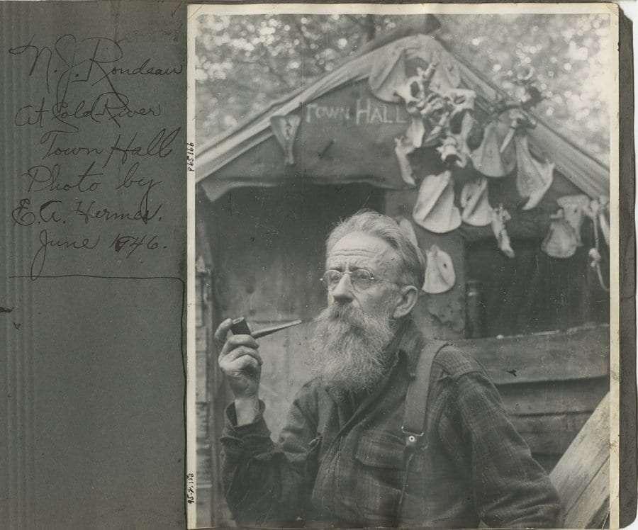 Hermit Noah John Rondeau smokes a pipe.