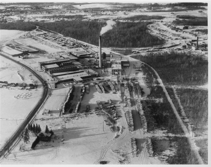 Tupper Lake's Oval Wood Dish factory in its heyday, with smoke drifting from the smokestack.