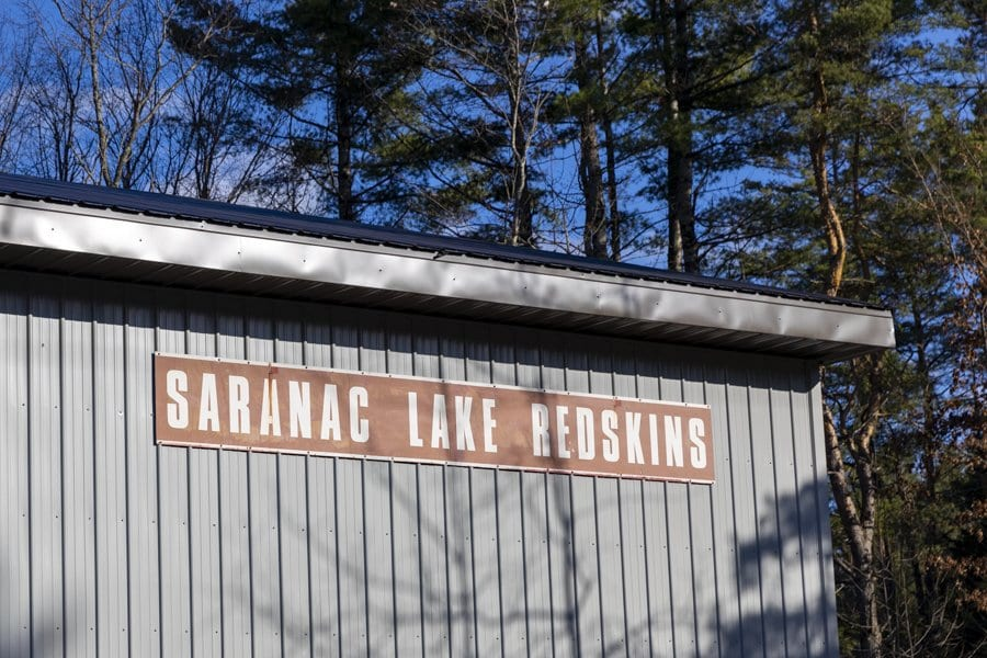 Holding the torch for the former Saranac Lake school mascot, the Redskins