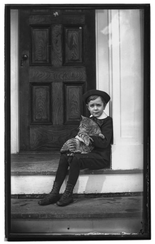boy with cat historic photo