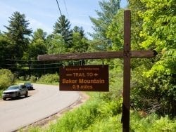 Cars park on the road's shoulder at Baker Mountain Trailhead.