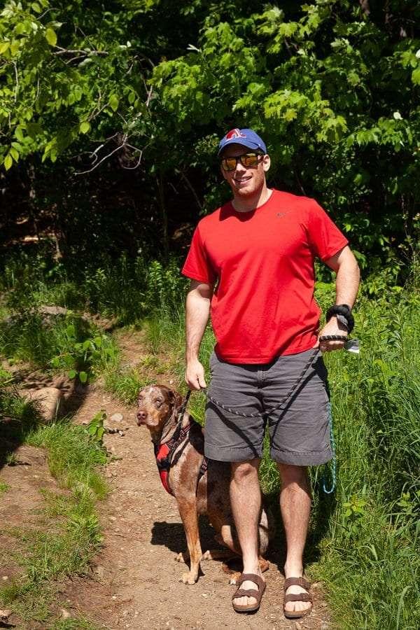 Tony Stephans hikes Baker Mountain with his dog.