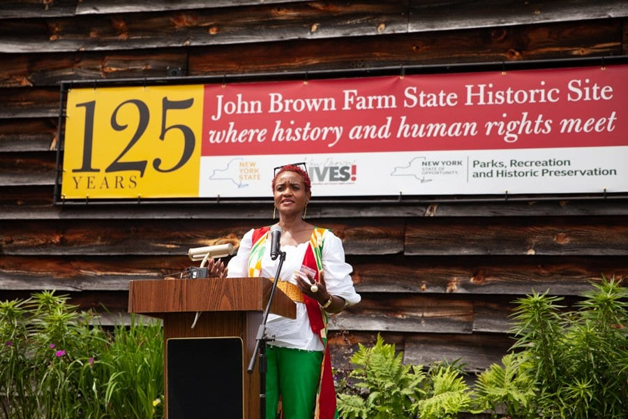 Nicole Hylton-Patterson speaks at the 125th anniversary of John Brown Farm State Historic Site.