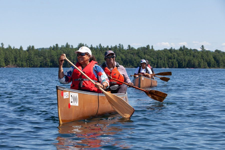 Canoeists paddle with Outdoor Afro.