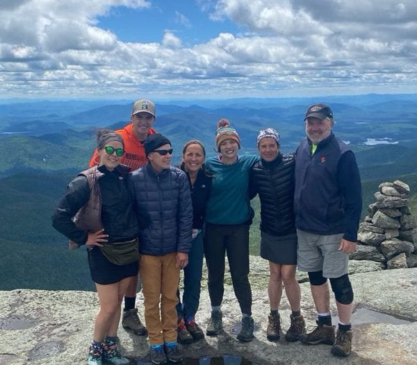 Publisher Tracy Ormsbee with friends hiking Mount Marcy.