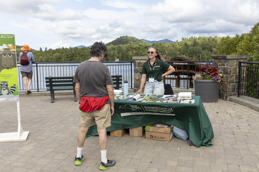 The state Department of Environmental Conservation doesn't have trailhead stewards. However, they have set up a booth for hikers in Mid's Park in Lake Placid. The DEC and several organizations are currently seeking more permanent solutions for reaching hikers. Photo by Mike Lynch